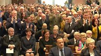 Priest challenges politicians at funeral