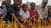Candles and prayers outside Sri Lankan church