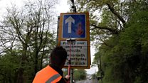 Meet the window cleaner washing road signs