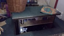 Counterfeit cigarettes hidden in hydraulic secret compartment