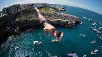 World's top cliff divers make splash in Italy
