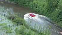Car stuck after driving through flood