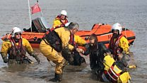 Stuck teens saved from mud as tide comes in