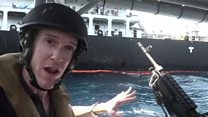 Close up to stricken oil tanker with the US Navy