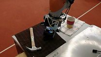 Robot taught to 'feel' objects by sight