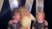 Kylie sings with bereaved twins