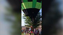 Wayward hot air balloon crashes into crowd