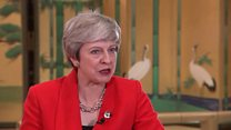 May: Russia must stop 'destabilising'