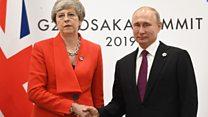 Unsmiling PM greets Putin in Japan