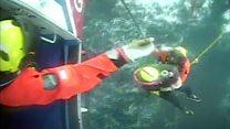 Fisherman rescued from boat in choppy water
