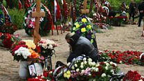 Russian submariners buried after fire