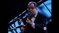 João Gilberto performs on stage