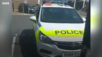 Man filmed driving unattended police car