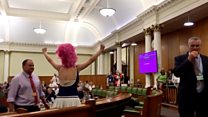 Climate protesters storm council meeting