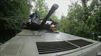 School-run dad picks up sons in tank