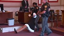 Former US judge dragged to jail