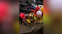 Footage captures moment of beach rocks rescue