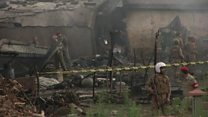 Pakistan military plane crash destroys homes