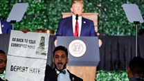 Protester interrupts Trump's democracy speech
