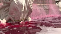 Fake-blood protest over French police raid