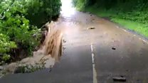 Homes and businesses hit by flash flooding