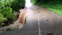 Bridge collapses in flash flooding