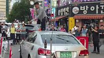 Korean man smashes Japanese car in protest