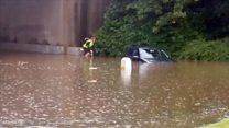 Cyclist makes it through Edinburgh flood water