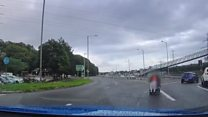 Dashcam captures wheelchair on roundabout