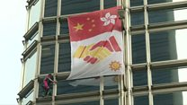 'Spiderman' scales HK skyscraper with peace banner