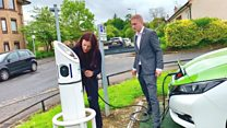 'How do I charge an electric car?'