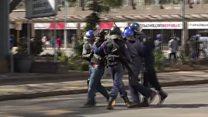Zimbabwe police break up protests
