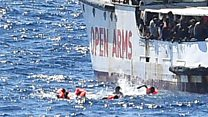 Migrants try to swim to Lampedusa