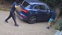 Moment driver fights off three masked men