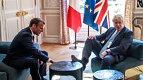 Boris sticks foot on table during talks with Macron