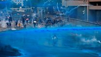 Water cannon fired at defiant Hong Kong protesters