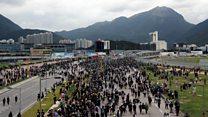 Pro-democracy protesters block Hong Kong airport