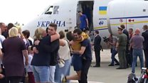 Freed Ukrainians greet families at Kiev airport