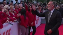 Tom Hanks leads sing-along with fans
