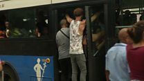 Cubans storm public transport to get to work