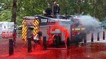 Extinction Rebellion spray fake blood on Treasury