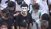 Hong Kong protesters burn banner after mask ban