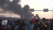 Iraq protests: Crowds free as tear gas is fired