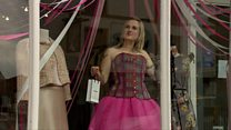 Real-life mannequins used to draw in customers