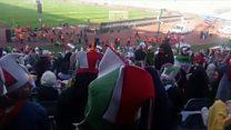 Female football fans cheer entry to Iran stadium