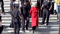 Jane Fonda led away in handcuffs over protest