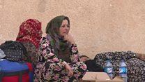 Ras al-Ain residents flee their homes