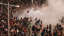 Police clash with protesters at Barcelona airport