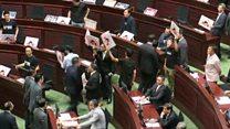 Protesting HK lawmakers disrupt leader's address