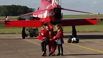 Families celebrate over Red Arrows return